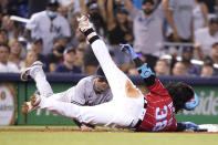 Miami Marlins' Jorge Alfaro (38) is safe at third as he beats the throw to New York Yankees third baseman Tyler Wade during the fourth inning of a baseball game, Saturday, July 31, 2021, in Miami. (AP Photo/Lynne Sladky)