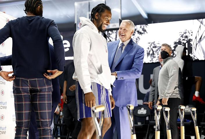 Clippers star Kawhi Leonard and team consultant Jerry West share a laugh.