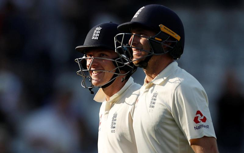Joe Buttler (right) and Dom Bess (left) walk off having saved England from embarrassment - REUTERS