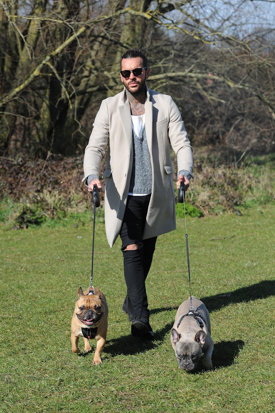 Pete Wicks and Megan Mckenna walk petes dogs as they film scenes for TOWIE.
