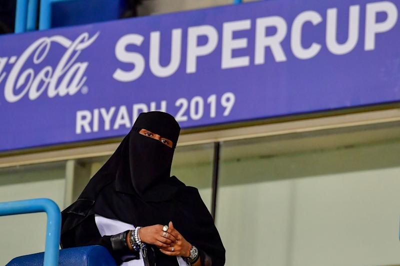 A Saudi woman arrives for the Supercoppa Italiana final football match between Juventus and Lazio at the King Saud University Stadium in the Saudi capital Riyadh on December 22, 2019. (Photo by GIUSEPPE CACACE / AFP) (Photo by GIUSEPPE CACACE/AFP via Getty Images)
