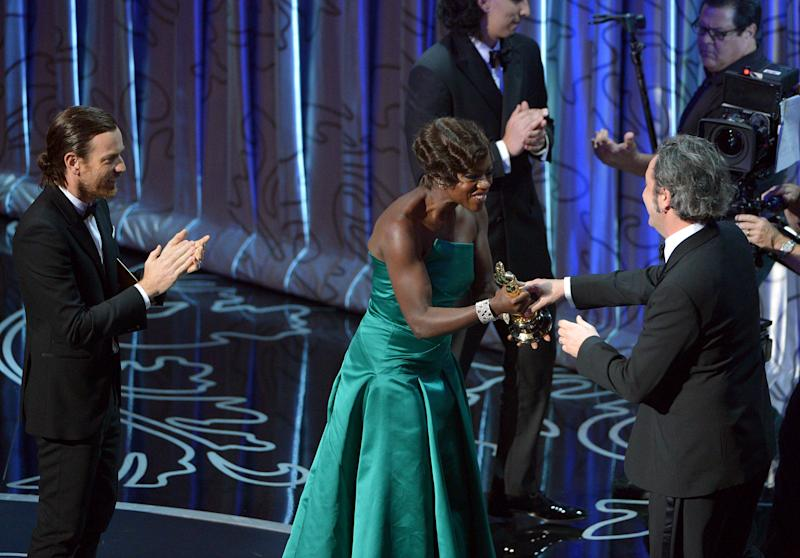 "Presenters Ewan McGregor, left, and Viola Davis present Paolo Sorrentino with the award for best foreign language film of the year for ""The Great Beauty"" during the Oscars at the Dolby Theatre on Sunday, March 2, 2014, in Los Angeles. (Photo by John Shearer/Invision/AP)"