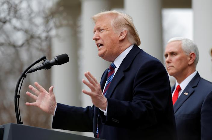 President Trump speaks to reporters in the Rose Garden on Friday as Vice President Mike Pence looks on. (Photo: Jim Young/Reuters)