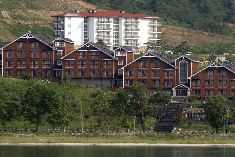 FILE - In this Sept. 1, 2011, file photo, South Korean invested villas line the coastline of the Mount Kumgang resort, also known as Diamond Mountain, in North Korea. North Korea on Friday, Nov. 15, 2019, said it issued an ultimatum to South Korea that it will tear down South Korean-made hotels and other facilities at the North's Diamond Mountain resort if the South continues to ignore its demands to come and clear them out.  (AP Photo/Ng Han Guan, File)