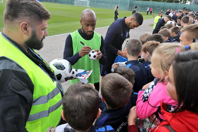Fabian Delph and Ruben Loftus-Cheek stop to sign autographs after the training session. (Getty)