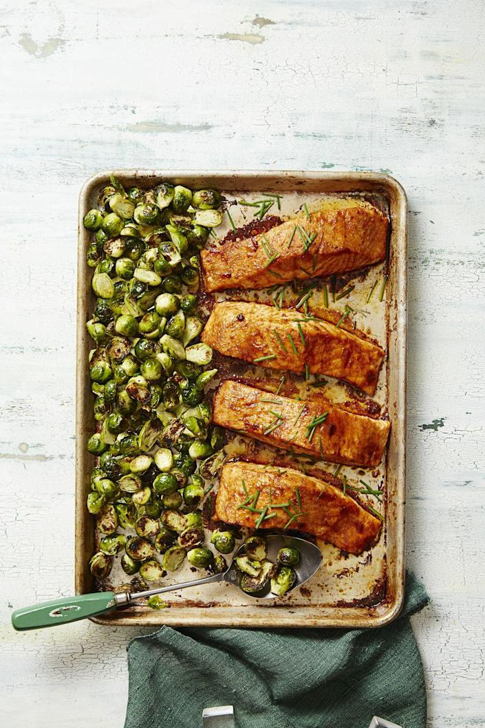 """<p>Here, two good-for-you staples (salmon + sprouts) roast up real nice in a 450°F oven on a single sheet pan.</p><p><em><a href=""""https://www.goodhousekeeping.com/food-recipes/a37311/bbq-salmon-brussels-bake-recipe/"""" rel=""""nofollow noopener"""" target=""""_blank"""" data-ylk=""""slk:Get the recipe for &quot;BBQ&quot; Salmon & Brussels Bake »"""" class=""""link rapid-noclick-resp"""">Get the recipe for """"BBQ"""" Salmon & Brussels Bake »</a></em> </p>"""