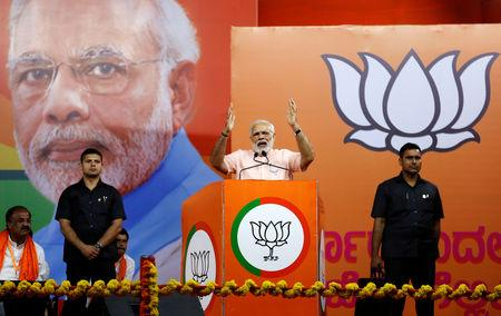 FILE PHOTO: India's Prime Minister Narendra Modi addresses an election campaign rally ahead of the Karnataka state assembly elections in Bengaluru, India, May 8, 2018. REUTERS/Abhishek N. Chinnappa/File Photo