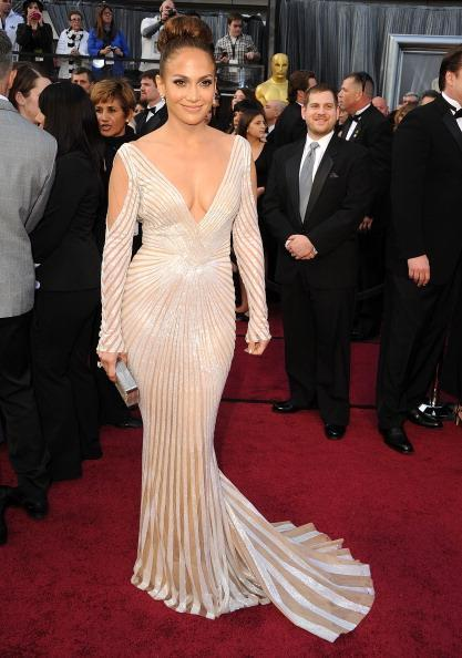 "<div class=""caption-credit""> Photo by: Getty Images</div><div class=""caption-title"">JLo at the Oscars</div>The only other Latina on Forbes' ""The Best Dressed at the Oscars"" list was diva Jennifer Lopez who wore a creamy gown from Zuhair Murad- one of her favorite designers. This fashionista was actually kept away from many of this year's glamorous red carpets as she traveled the world for her international music tour."