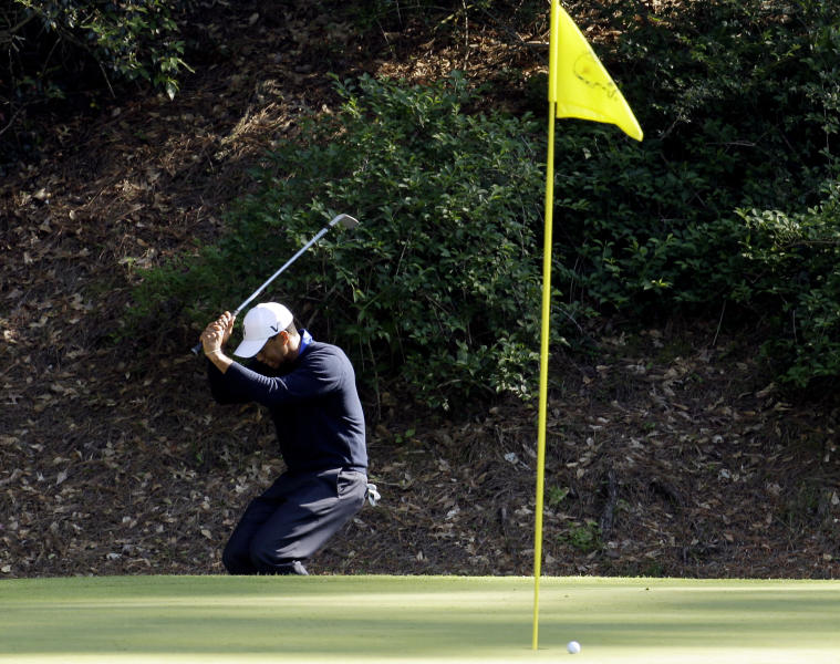 Tiger Woods reacts to missing a birdie chip on the 12th green during the second round of the Masters golf tournament Friday, April 6, 2012, in Augusta, Ga. (AP Photo/Charlie Riedel)