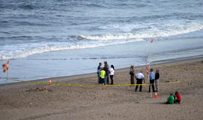 Maryland State Police, Ocean City Police, Ocean City Beach Patrol and other emergency responders set-up command post on the beach at Ocean City, Md., during search fa a single-engine CJ-6A plane that crashed into the ocean on Sunday, June 30, 2013. Ocean City Mayor Rick Meehan says the pilot is presumed dead. (AP Photo/Courtesy Ed Tobias)