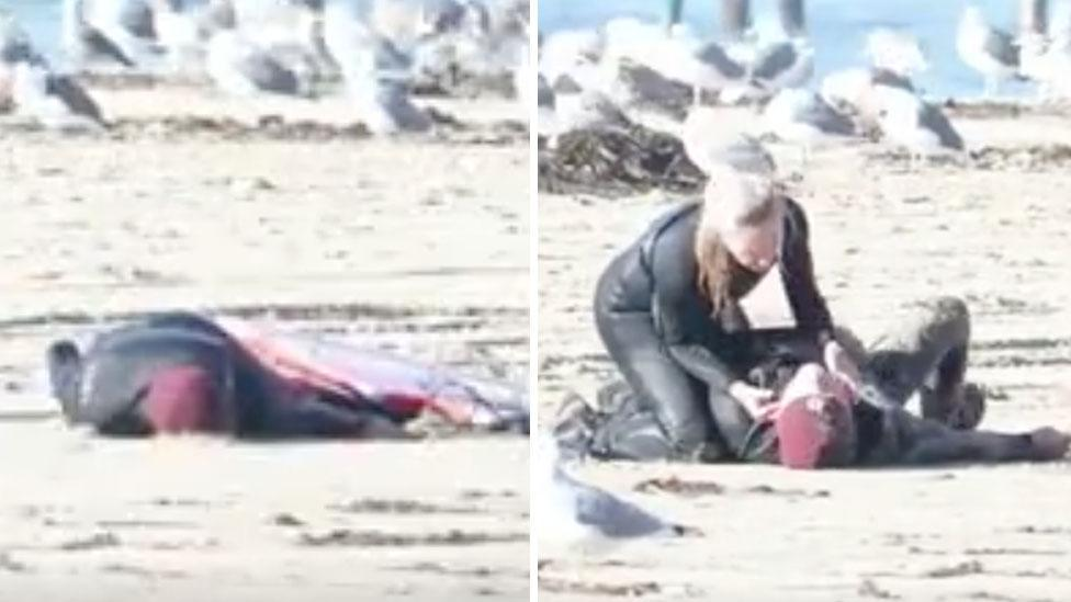 Andi Traynor gives Max Montgomery CPR after he collapses on the beach. Source: Paddle4Good/Alexander Baker