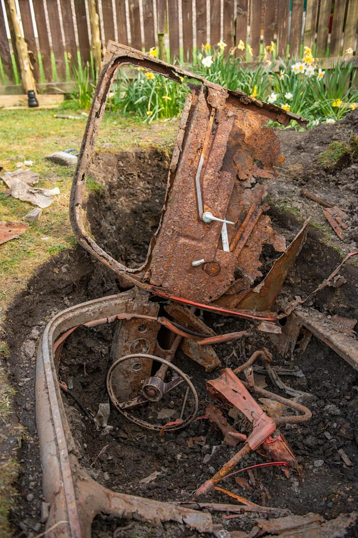 He has no idea how the car ended up buried under his lawn. (Picture: SWNS)