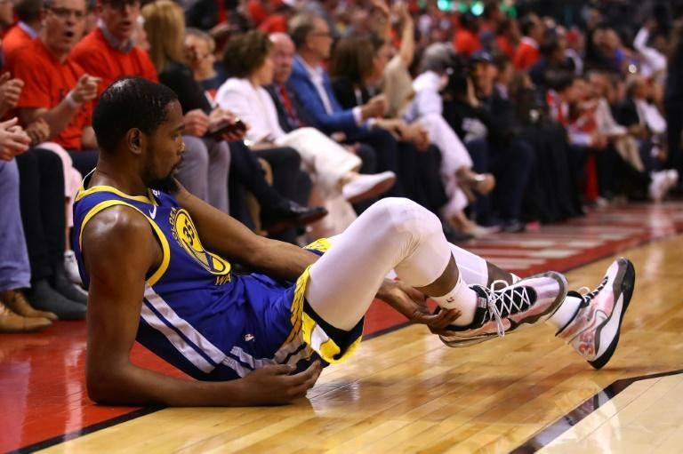 Golden State Warriors star Kevin Durant reacts after sustaining an injury in the second quarter of game five of the 2019 NBA Finals against the Toronto Raptors