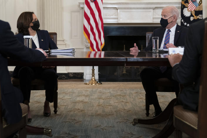 President Joe Biden speaks with Vice President Kamala Harris about the southern border during a meeting in the State Dining Room of the White House, Wednesday, March 24, 2021, in Washington. (AP Photo/Evan Vucci)