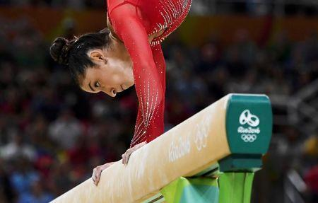 2016 Rio Olympics - Artistic Gymnastics - Final - Women's Individual All-Around Final - Rio Olympic Arena - Rio de Janeiro, Brazil - 11/08/2016. Alexandra Raisman (USA) of USA (Aly Raisman) competes on the beam during the women's individual all-around final. REUTERS/Dylan Martinez