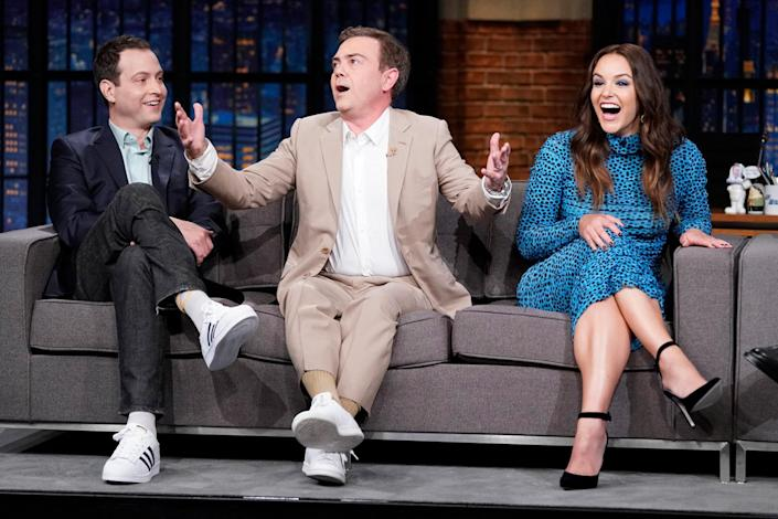 <p><em>Brooklyn Nine-Nine</em>'s Dan Goor, Joe Lo Truglio and Melissa Fumero share a moment while saying goodbye to their series on Sept. 16 during an interview on <em>Late Night with Seth Meyers </em>in N.Y.C. following the show's finale. </p>
