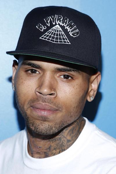FILE - In this Saturday, Oct. 20, 2012 file photo, singer Chris Brown attends the Qubeey launch of the Chris Brown Channel in Beverly Hills, Calif. Brown returns to a Los Angeles court on Thursday Nov. 1, 2012 to address questions raised by prosecutors and a judge about his completion of his community labor sentence for the 2009 beating of then-girlfriend Rihanna. (Photo by Joe Kohen/Invision/AP, File)