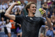 Alexander Zverev, of Germany, throws game balls to the crowd after defeating Lloyd Harris, of South Africa, during the quarterfinals of the US Open tennis championships, Wednesday, Sept. 8, 2021, in New York. (AP Photo/Elise Amendola)