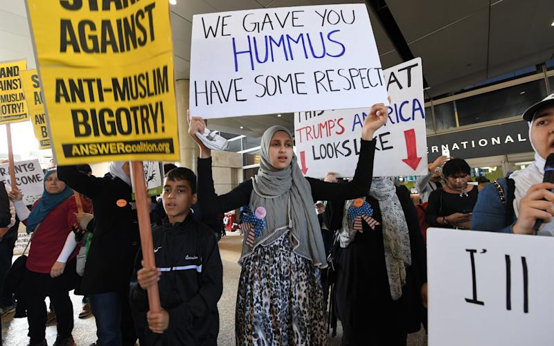 Muslim Ban Protesters chant and march at Bradley Terminal at Los Angeles International Airport LAX on Saturday on February 4, 2017 in Los Angeles, California. - Credit: JPI Studios / Barcroft Images/PI Studios / Barcroft Media