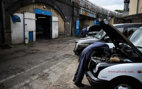 Working on taxis in Bow - Credit: Leon Neal/Getty Images Europe