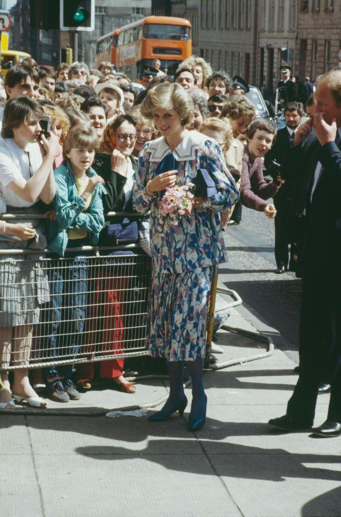 <p>By the time she became pregnant with her second child, Diana had settled into her royal style a bit more—and as a result, she wore maternity looks that fit better into the image of Diana that we remember. Here, she wears a printed two-piece outfit with blue tights and heels for a visit to the Albany Center in May 1984.<br></p>