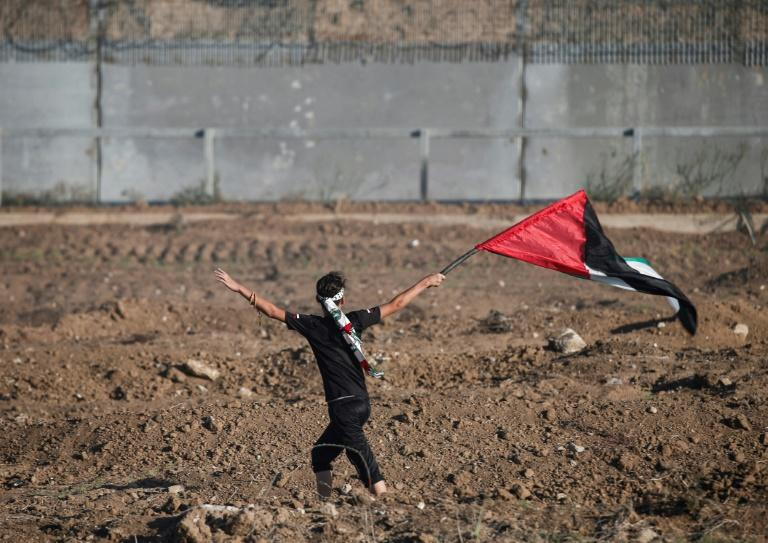 The Palestinian Authority will receive a transfer of 1.5 billion shekels ($430 million) from Israel, officials from the two governments said Friday, in a step towards resolving a months-long standoff; a  young protester waves a Palestinian flag on October 4, 2019
