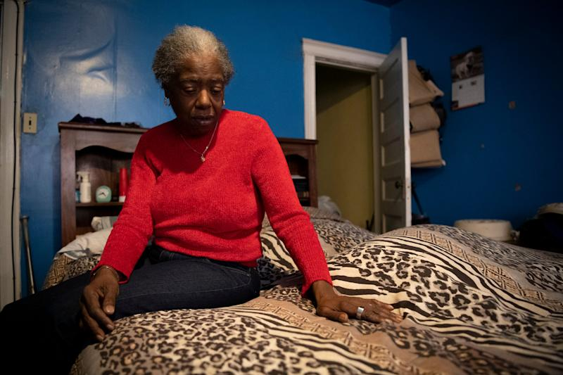 Patricia Blair sits in the master bedroom she and her husband Richard shared. In 2016 she found him here in their bed after he passed away from heart problems. She said she still thinks of that day every time she goes to bed.