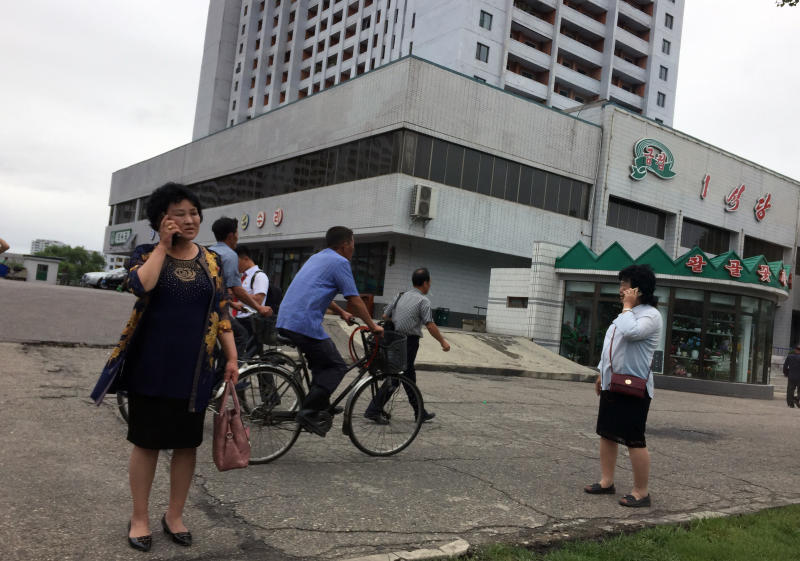 <p> Residents go about their business near one of the city's biggest department stores and shopping areas in Pyongyang, North Korea Sunday, June 10, 2018. Despite the focus of world attention on the upcoming summit in Singapore between US President Donald Trump and North Korean leader Kim Jong Un, many North Koreans remain in the dark about what is happening outside their isolated nation. (AP Photo/Eric Talmadge) </p>