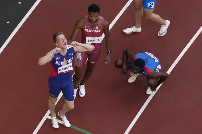 Karsten Warholm, of Norway, celebrates after winning a gold medal during the finals of the men's 400-meter hurdles at the 2020 Summer Olympics, Tuesday, Aug. 3, 2021, in Tokyo. (AP Photo/Morry Gash)