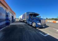 A Peterbilt 579 truck equipped with Aurora's self-driving system is seen at the company's terminal in Palmer