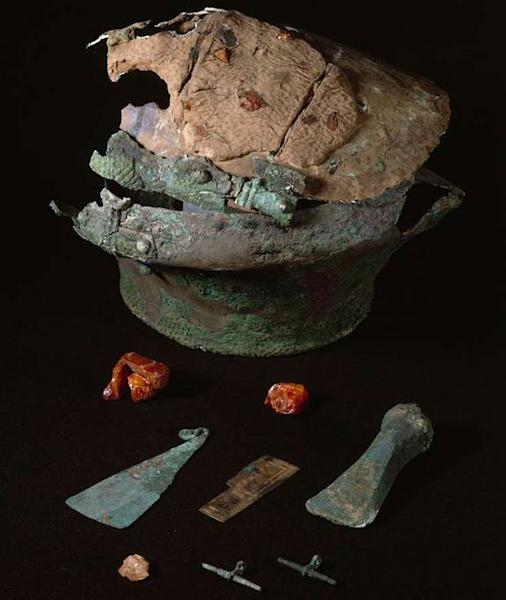 """A bronze urn and bronze and amber items from the Lusehøj grave, where researchers found the bones of what they think is a Scandinavian man along with bits of """"luxurious"""" fabric made from imported nettles."""