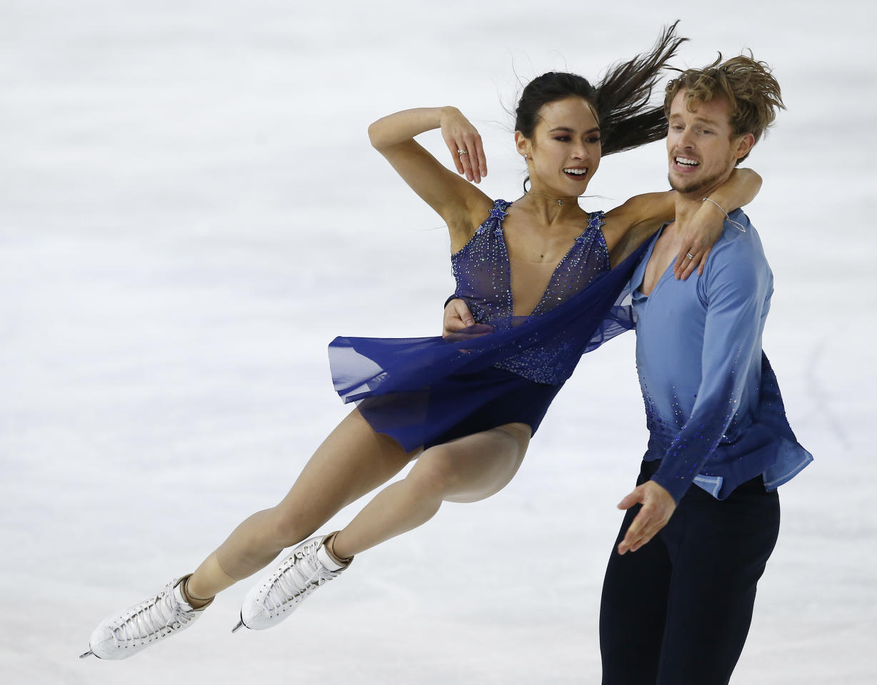 <p>Ice dancing duo Madison Chock and Evan Bates grew up skating together as kids. Their first date was on Madison's 16th birthday, although they skated with other partners earlier in their careers. (AP) </p>