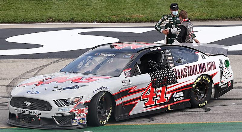 SPARTA, KENTUCKY - JULY 12: Cole Custer, driver of the #41 HaasTooling.com Ford, is congratulated by Kevin Harvick, driver of the #4 Hunt Brothers Pizza Ford, after winning the NASCAR Cup Series Quaker State 400 Presented by Walmart at Kentucky Speedway on July 12, 2020 in Sparta, Kentucky. (Photo by Rob Carr/Getty Images) | Getty Images