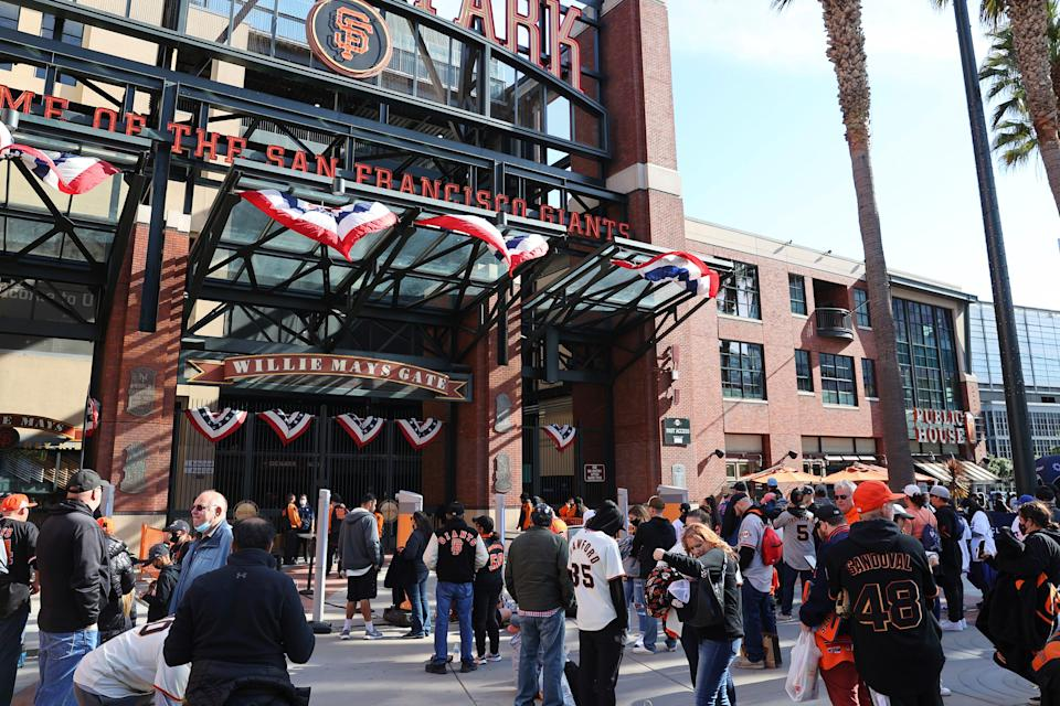 Fans arrive at Oracle Park before Game 1 against the Dodgers.