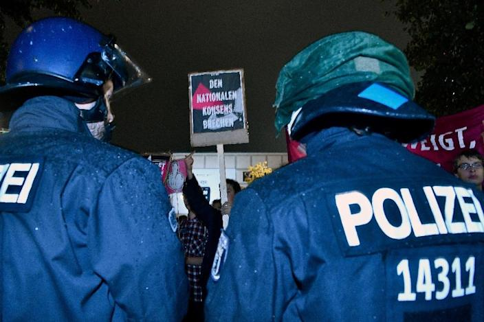Riot police are on guard during protests outside an election night event in Berlin for the Alternative for Germany (AfD) party, which is set to become the country's third biggest political force (AFP Photo/John MACDOUGALL)