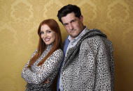 """Jessica Chastain, left, the star of """"The Eyes of Tammy Faye,"""" poses for a portrait with director Michael Showalter during the 2021 Toronto International Film Festival, Sunday, Sept. 12, 2012, at the Royal Fairmont York in Toronto. (AP Photo/Chris Pizzello)"""