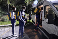Carver College gets in their van before heading back to Atlanta, Ga after their NCAA college basketball game against Florida International Monday, Dec. 21, 2020, in Miami. (AP Photo/Gaston De Cardenas)