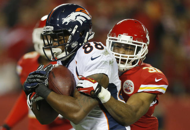 Denver Broncos wide receiver Demaryius Thomas (88) runs as Kansas City Chiefs cornerback Marcus Cooper (31) tries to tackle him during the second half of an NFL football game, Sunday, Dec. 1, 2013, in Kansas City, Mo. (AP Photo/Ed Zurga)