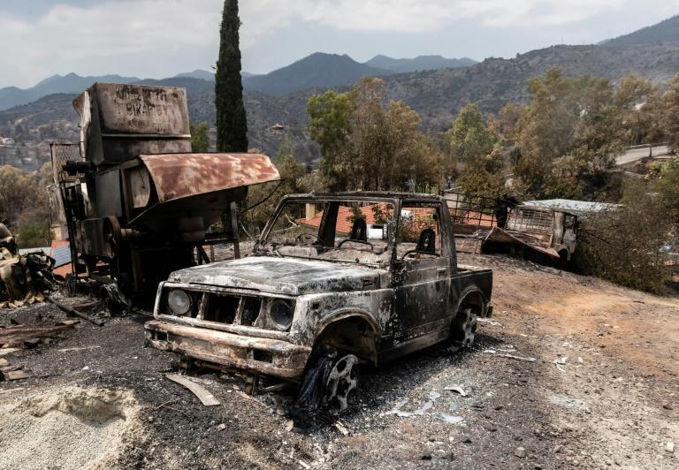A picture taken on July 4, 2021 shows destroyed vehicles at Ora village on the southern slopes of the Troodos mountains in Cyprus