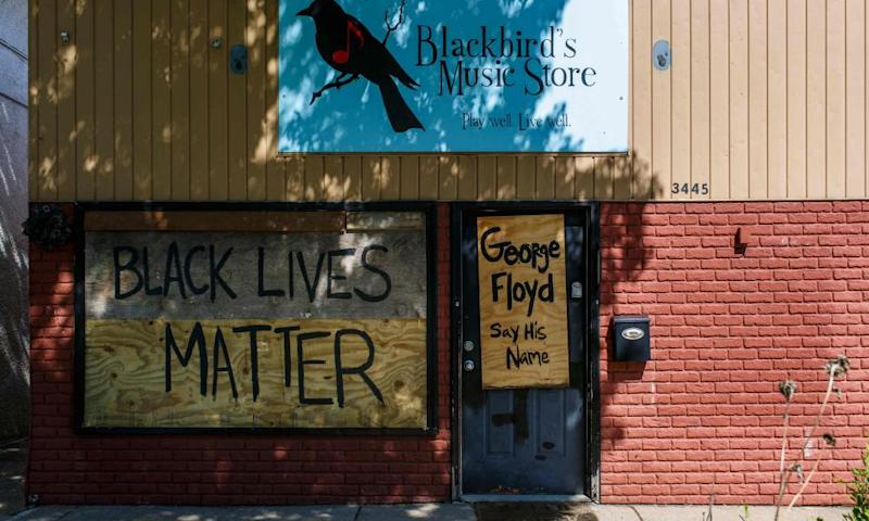 A store is boarded up as local businesses protect themselves against looting and demonstrations on 30 May 2020 in Minneapolis.