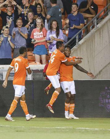 Jul 18, 2018; Houston, TX, USA; Houston Dynamo forward Romell Quioto (31) celebrates with midfielder Darwin Ceren (24) after scoring a goal during the second half against Sporting Kansas City at BBVA Compass Stadium. Mandatory Credit: Troy Taormina-USA TODAY Sports