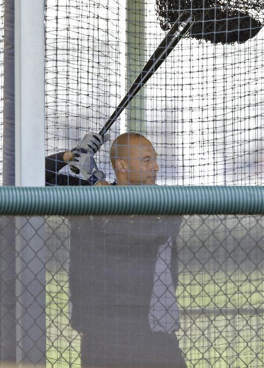 New York Yankees shortstop Derek Jeter hits in a batting cage during a workout at the baseball team's minor league facility Thursday, Feb. 13, 2014, in Tampa, Fla. Jeter announced he will retiring at the end of the 2014 season. (AP Photo/Chris O'Meara)
