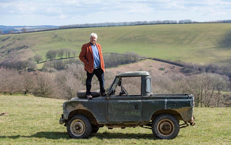 Stanley Johnson stands on a truck on his estate - Dale Cherry
