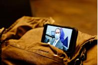 <p>A journalist watches their mobile phone showing Derek Chauvin as the verdict in his trial over the death of George Floyd is announced on April 20.</p>