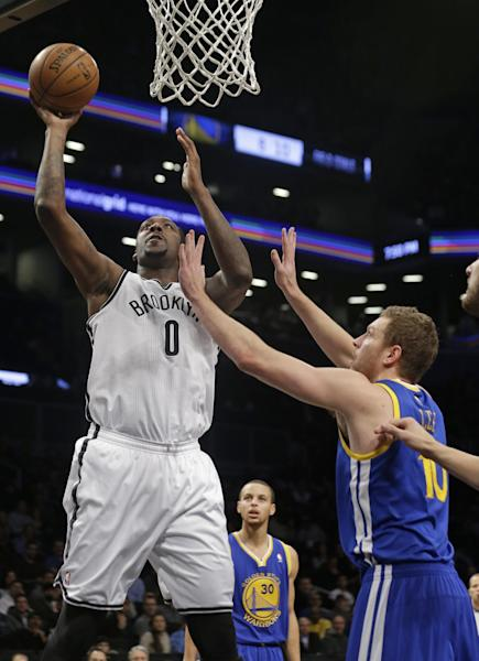 Brooklyn Nets' Andray Blatche (0) shoots over Golden State Warriors' David Lee (10) during the first half of an NBA basketball game Wednesday, Jan. 8, 2014, in New York. (AP Photo/Frank Franklin II)