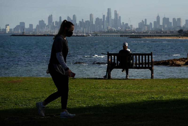 Victorian woman takes a stroll amid daylight saving debate.