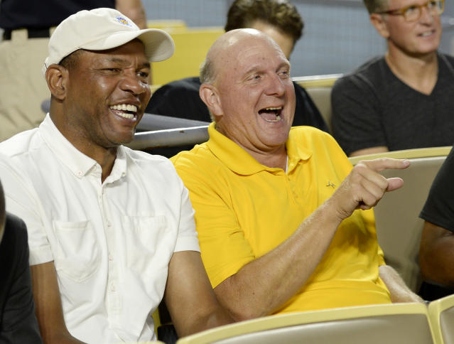 Steve Ballmer (right) and Doc Rivers share a hearty laugh at our tax code. (AFP/Kevork Djansezian)