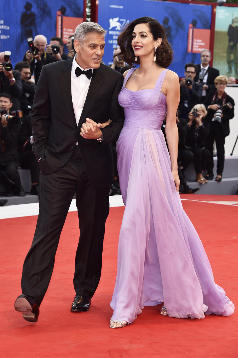 George Clooney and Amal Clooney walk the red carpet ahead of the 'Suburbicon' screening during the 74th Venice Film Festival. (Pascal Le Segretain via Getty Images)