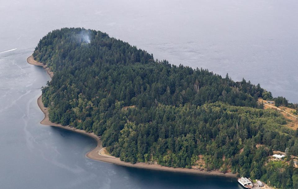 BEEBO'S LAST FLIGHT: After completing a barrel roll, Russell crashed into Ketron Island in Puget Sound, just off the shore between Olympia and Tacoma. - Credit: Ted S. Warren/AP