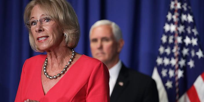 """US Secretary of Education Betsy DeVos speaks as Vice President Mike Pence listens during a White House Coronavirus Task Force press briefing at the US Department of Education July 8, 2020 in Washington, DC. <p class=""""copyright"""">Alex Wong/Getty Images</p>"""